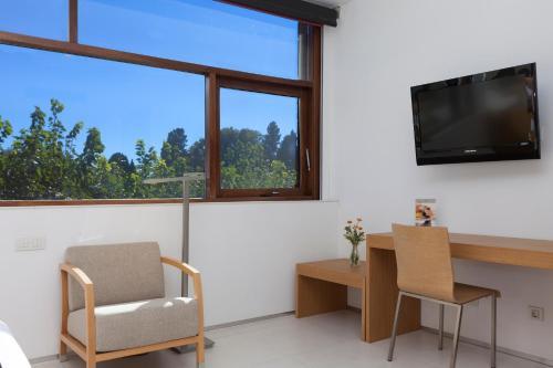 Habitación Triple URH - Hotel Molí del Mig 3