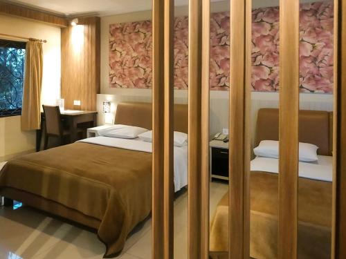 Kamar Superior Queen dengan 2 Tempat Tidur Queen (Superior Queen Room with Two Queen Beds)