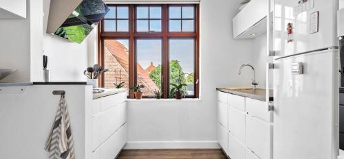 Stay Bai-Jensen, Pension in Odense