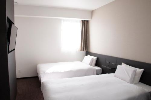 E hotel Koshigaya image