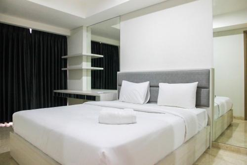 Sea View 1BR at Gold Coast Apartment near PIK By Travelio, North Jakarta