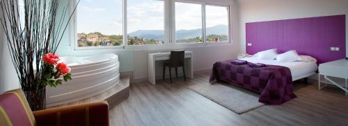 Suite mit Queensize-Bett und Whirlpool Luces del Poniente 3