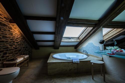 Suite Deluxe con bañera de hidromasaje - Uso individual Posada Real La Carteria 16