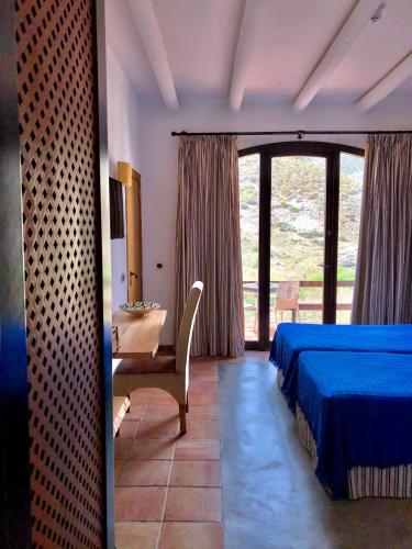 Habitación Doble con cama supletoria (3 adultos) Cortijo El Paraíso 8