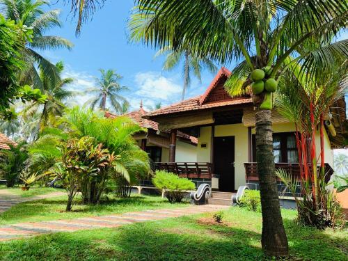 . Maadathil Cottages