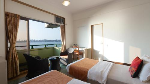 Kamar Superior Double atau Twin dengan Pemandangan Laut (Superior Double or Twin Room with Sea View)