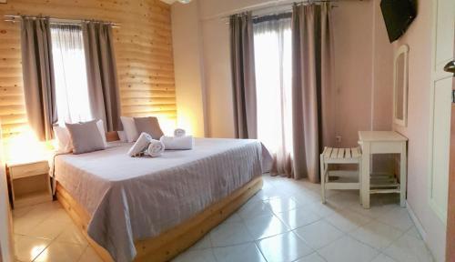 Фото отеля Anemos Hotel