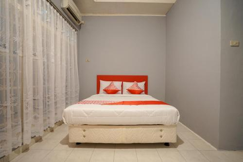 Фото отеля OYO 1026 Cendrawasih Residence