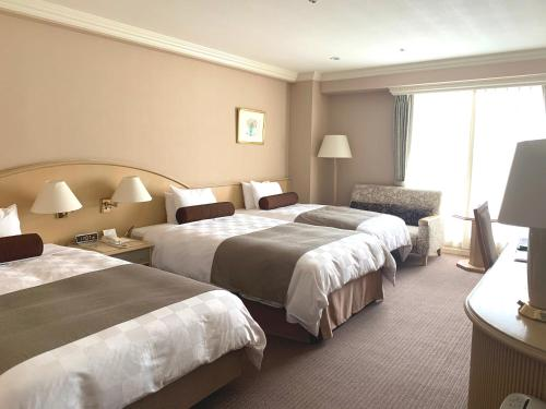 Twin Room with Extra Bed (3 Adults) - North & South Wing -Non-Smoking