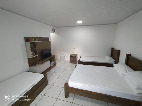 Edícula com piscina e suíte (Photo from Booking.com)