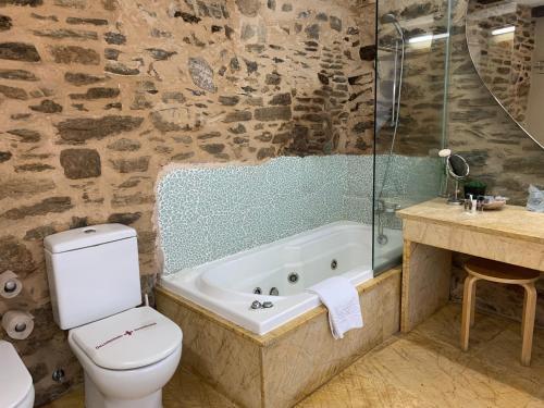 Suite con bañera de hidromasaje - Uso individual Posada Real La Carteria 26