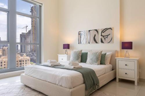 Modern Apt with Balcony near Burj by GuestReady