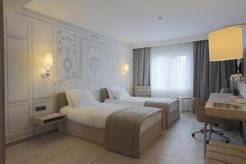 Balsamo Hotel & Suites фото номерів