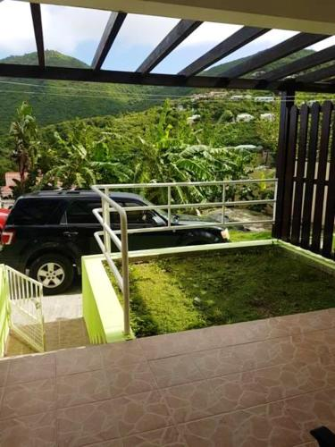. Apartment with one bedroom in La Savane with wonderful mountain view furnished garden and WiFi 2 km from the beach