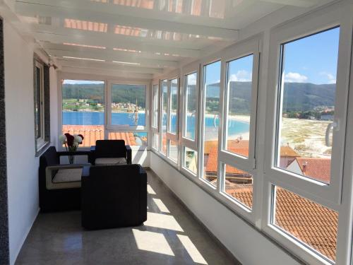 . Apartment with 2 bedrooms in Laxe with wonderful sea view and furnished terrace 80 m from the beach