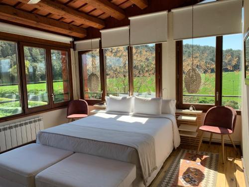 Habitación Doble con vistas al jardín Hotel Masia La Palma 1