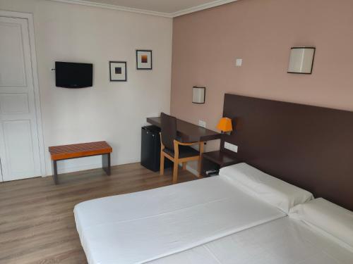 Habitación cuádruple Hotel Arrope 2