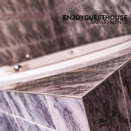 Enjoy Guest House E Apartments. - Photo 7 of 44