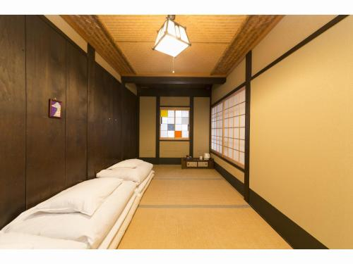 基本三人房-附共用衛浴 (Basic Triple Room with Shared Bathroom)