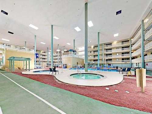 Top-Floor Corner Villa with Pools, Tennis & Gym condo