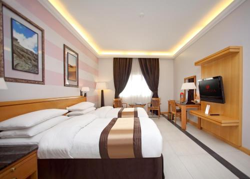 . Ramada Qurum Beach Hotel