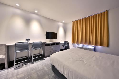 Hôtel Ô Suites - Photo 2 of 50