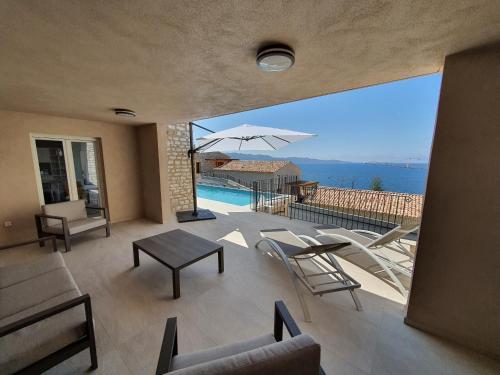 MOR401 - T5 Neuf piscine vue mer panoramique - Location saisonnière - Saint-Florent