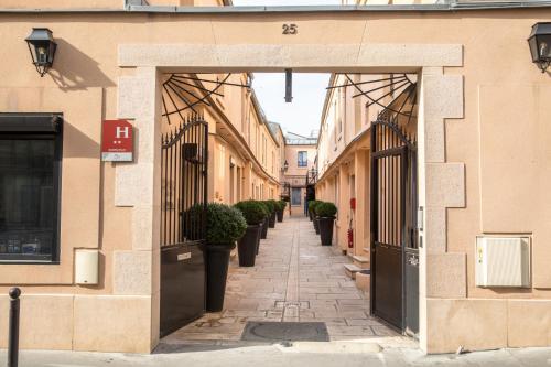 Hotel De L'Horloge - Hôtel - Paris