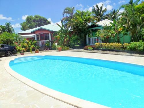 Maison de 3 chambres a Petit Canal avec piscine partagee terrasse amenagee et WiFi - Location saisonnière - Petit-Canal
