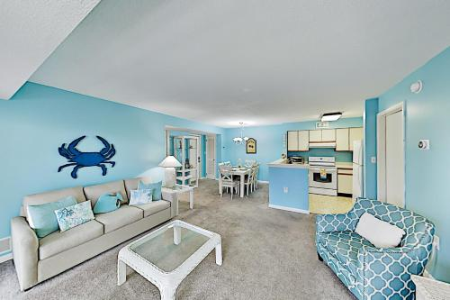 . Oceanside Gem with Private Deck, Canal Views & Pools condo