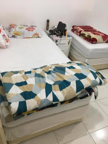 Ladies single bedspace in front of Karama Center!