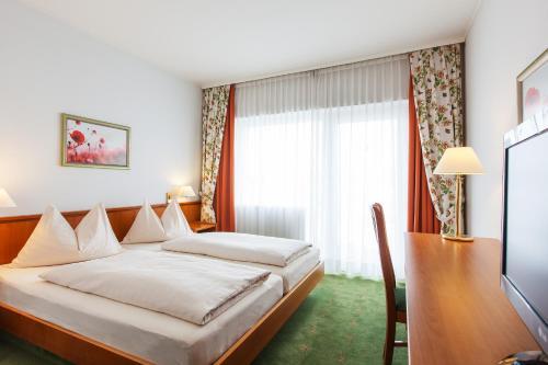 Фото отеля Landzeit Motor-Hotel St. Valentin