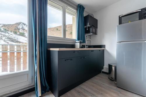 Un appartement coquet au pied des pistes - Hotel - Val Louron