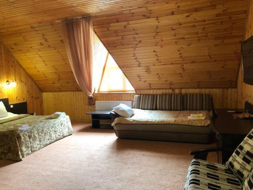 Snezhniy Bars Dombay - Hotel