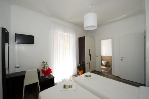 Kamar Double atau Twin dengan Balkon (Double or Twin Room with Balcony)