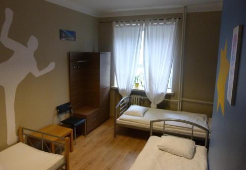 Hostel Camera Трехместный номер с общей ванной комнатой