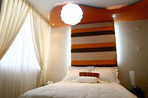 Hotel Taymi Hostal & Suites