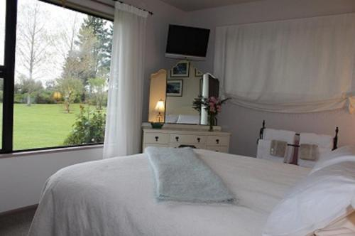 Rom med queen-size-seng og hageutsikt   (Queen Room with Garden View)
