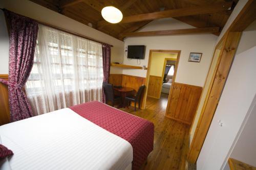 Фото отеля Sanctuary House Resort Motel