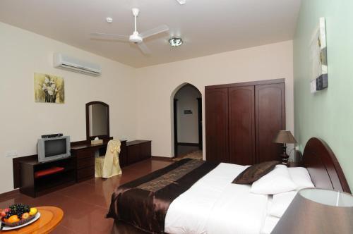 Green Oasis Hotel room photos