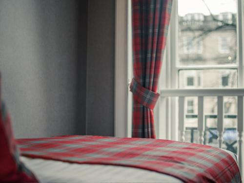 6 Buckingham Terrace, Glasgow G12 8EB, Scotland.