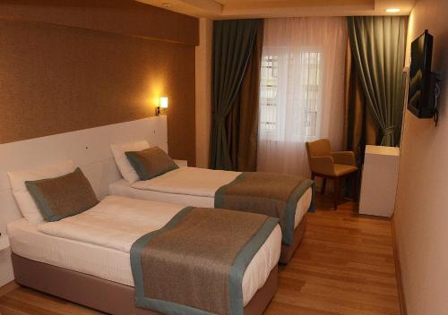 Parion House Hotel Zimmerfotos
