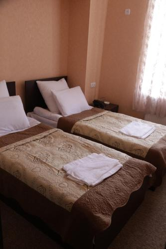 Cameră twin cu vedere la oraş (Twin Room with City View)