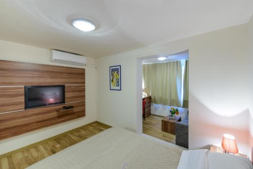 Quarto Triplo Superior (Superior Triple Room)