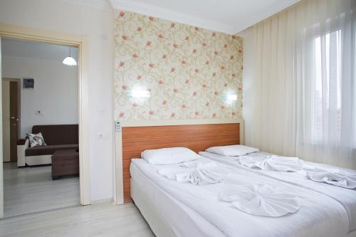 Cameră triplă cu balcon (Triple Room with Balcony)