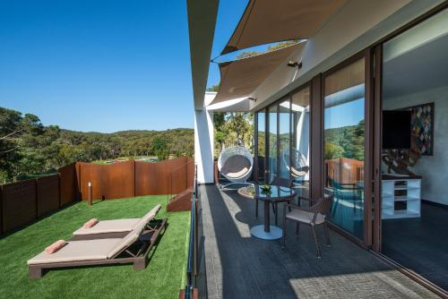 Suite with Jacuzzi® and Private Garden Suites Natura Mas Tapiolas 47