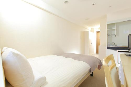 Quarto Seleccionado no Check-In - Não Fumador - 1 Adulto (Room Selected at Check-In - Non-Smoking - 1 Adult)
