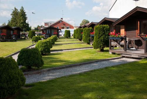 . Milano Garden - City Bungalow Hotell, i gränslandet till Kullabygdens pärlor