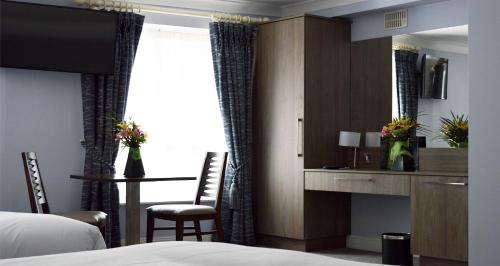. Slaney Suites