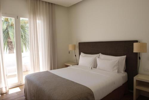 Double Room with Garden View and Balcony Hostal Spa Empúries 7